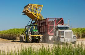 In-field equipment transloading into highway trucks