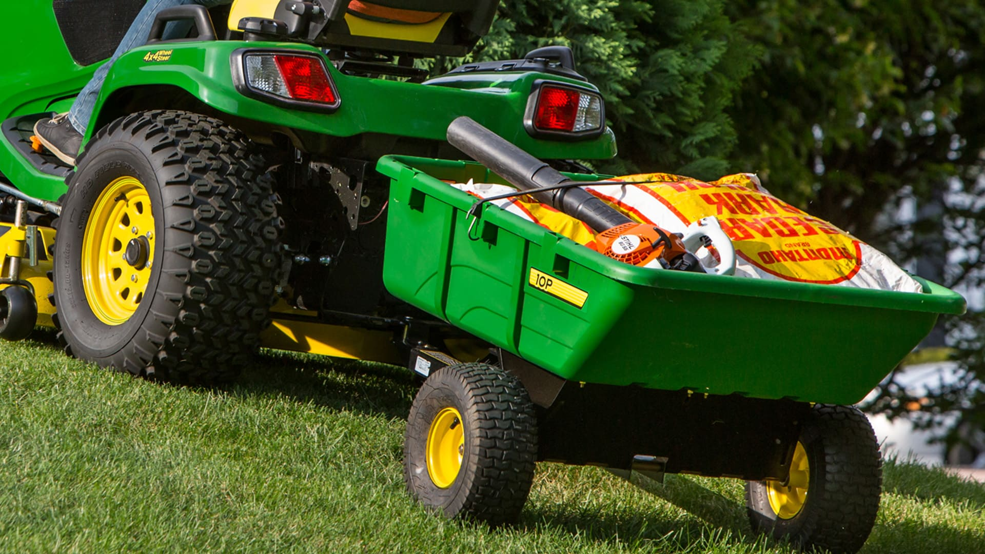 Ride on mower cart attachment for convenient yard work.