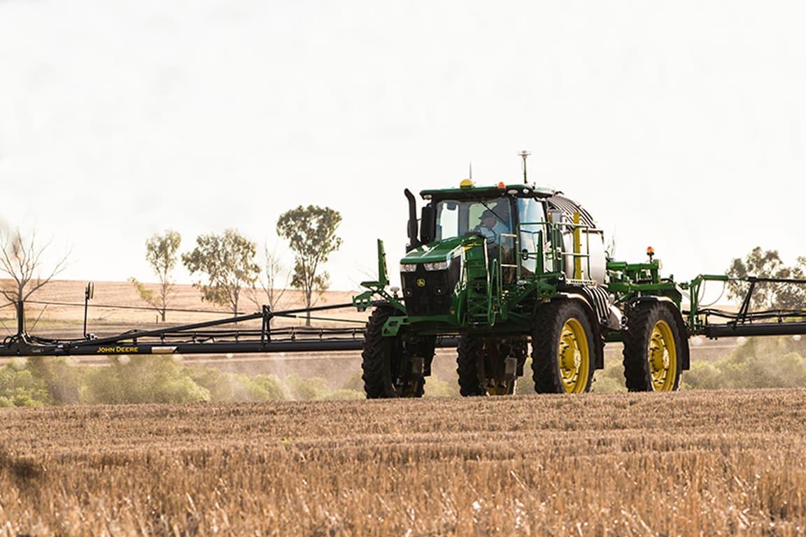 John Deere sprayer in a field
